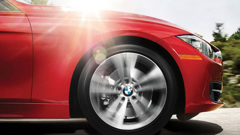 Close Up Of Wheel Spinning on Red BMW
