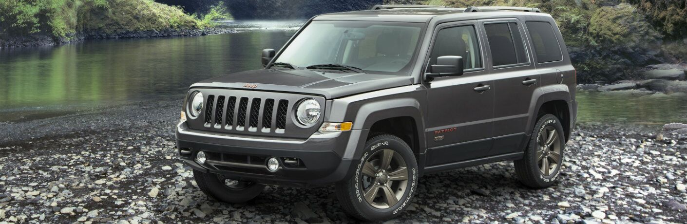 Silver Jeep Patriot Parked on Rocks