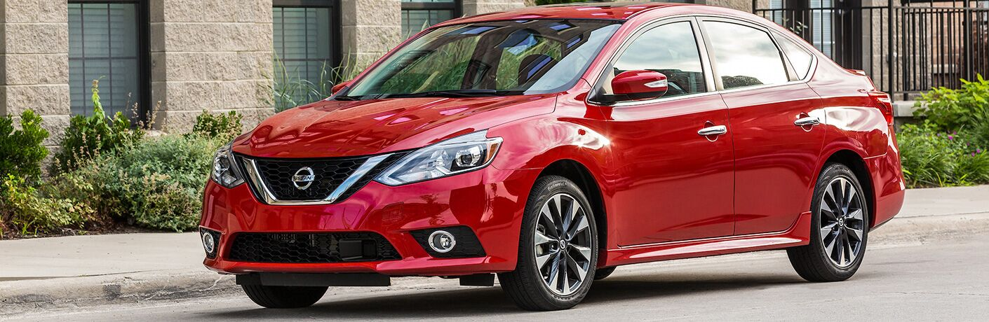 red 2019 Nissan Sentra parked in city