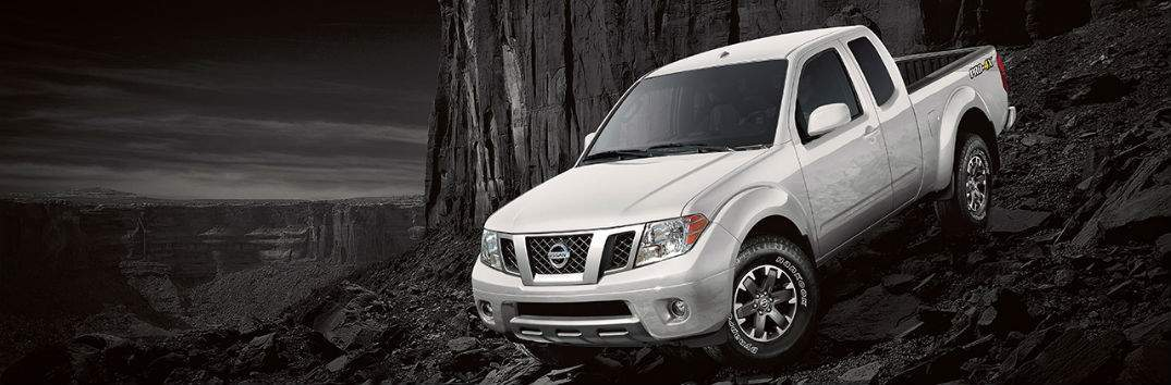2018 nissan frontier white front and side exterior