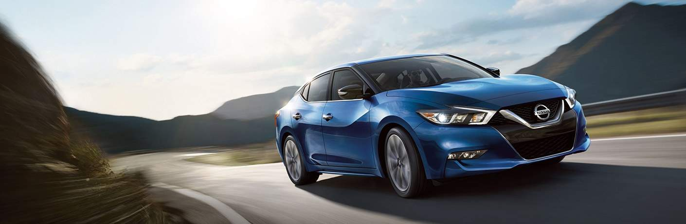 blue 2018 nissan maxima driving on highway