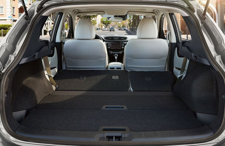 rear cargo space of 2018 nissan rogue sport with rear seats folded down