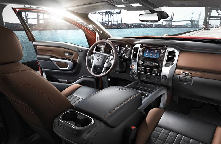 front interior of 2018 nissan titan xd including steering wheel, center console and infotainment system
