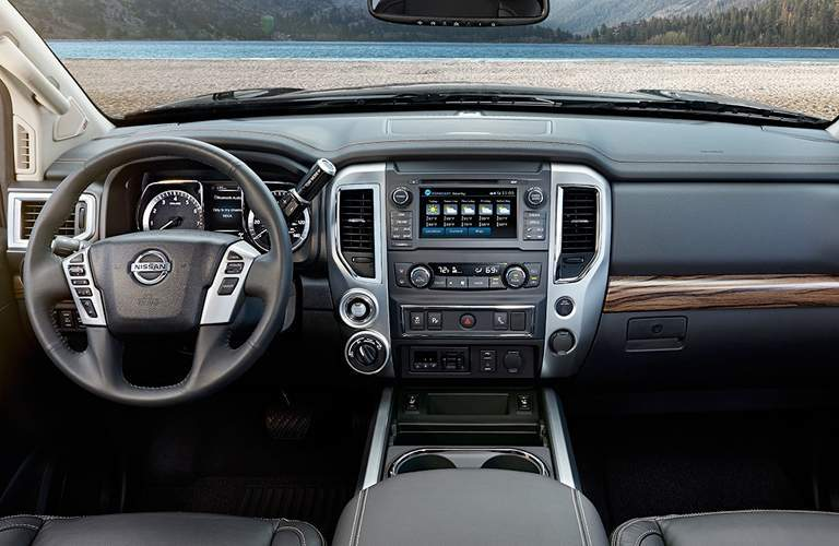 front interior cab of 2018 nissan titan including steering wheel, dashboard and infotainment system