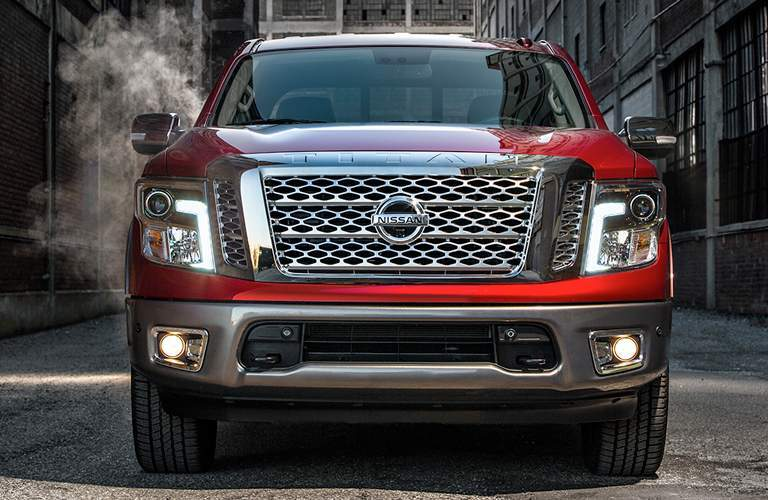front bumper and grille of red 2018 nissan titan