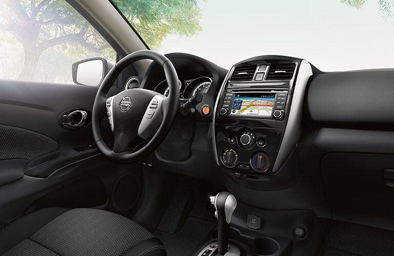 front interior of 2018 nissan versa note including steering wheel, windshield and infotainment system