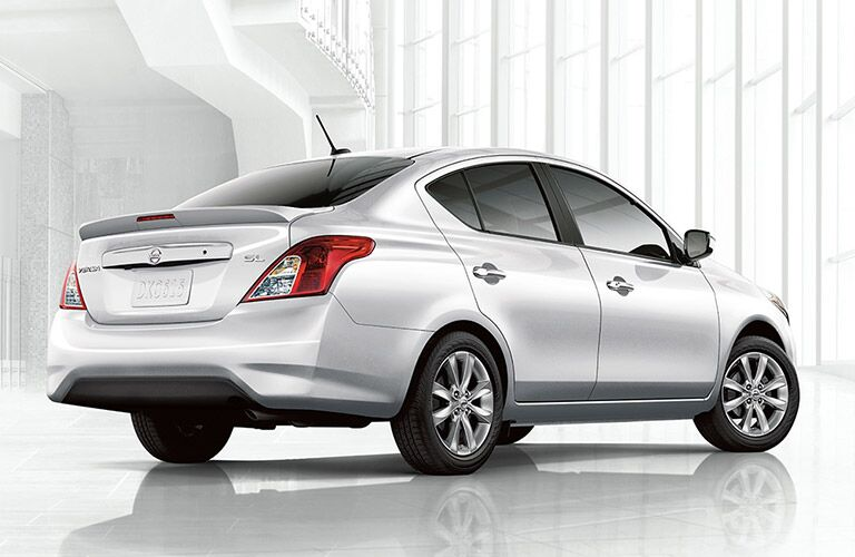 rear view of white 2018 nissan versa against white background