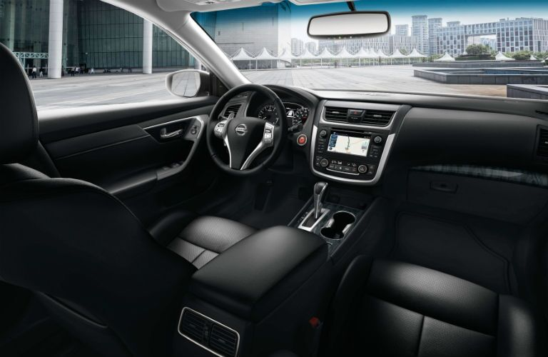 front interior of 2018 nissan altima including seats, dashboard and center infotainment system