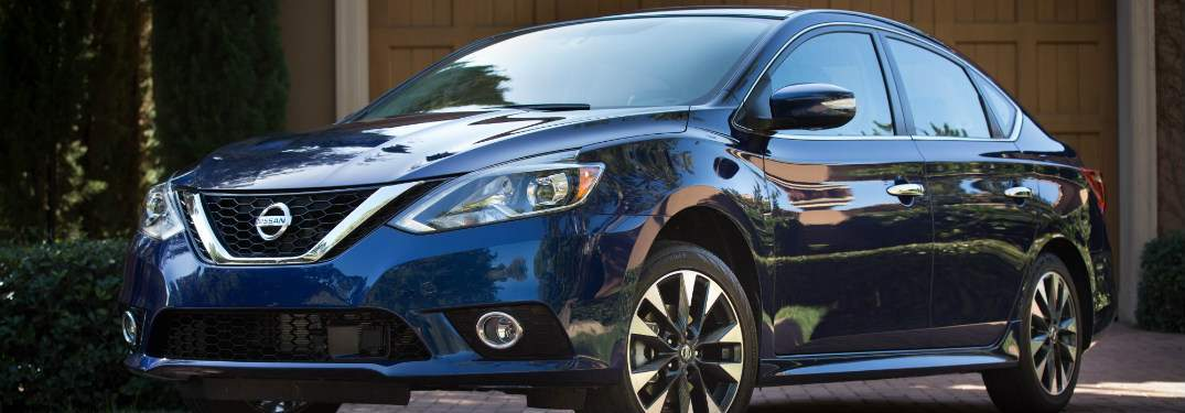 blue 2018 nissan sentra parked in front of driveway
