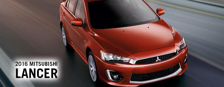 red 2016 Mitsubishi Lancer driving