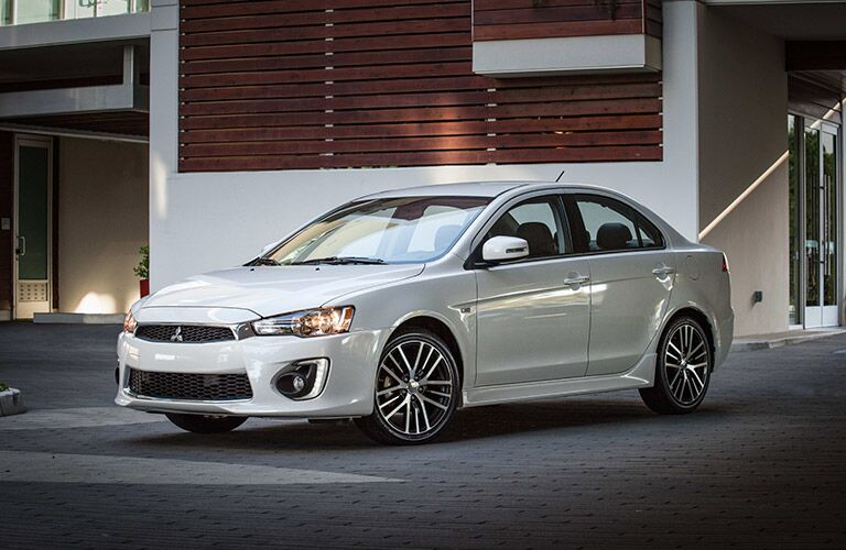 white 2017 Mitsubishi Lancer parked exterior front side