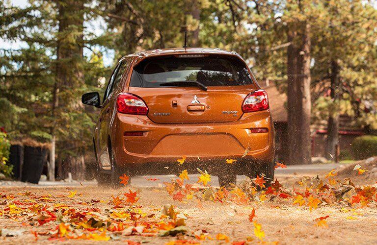 2017 Mitsubishi Mirage driving through leaves