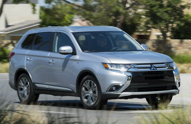 2017 Mitsubishi Outlander driving down a city street