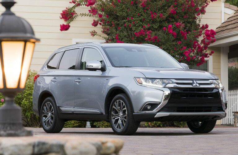silver 2017 Mitsubishi Outlander parked outside home