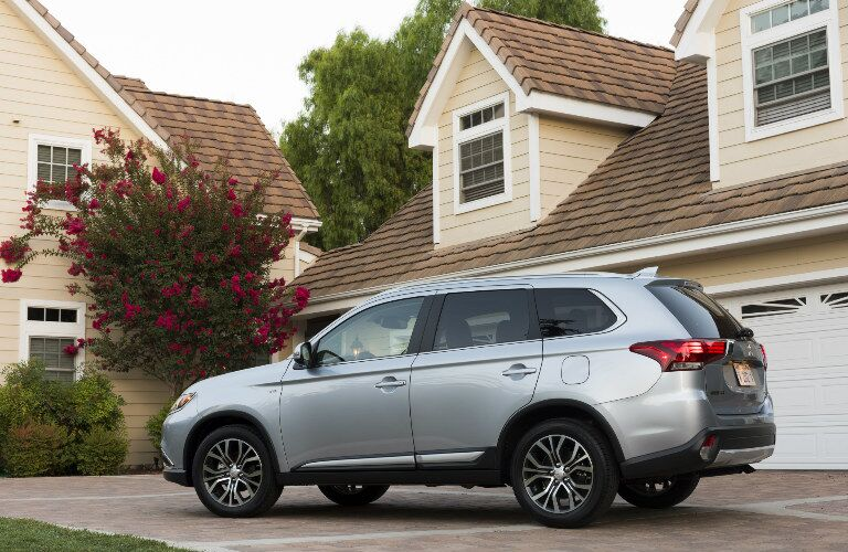 silver 2017 Mitsubishi Outlander parked outside house side angle