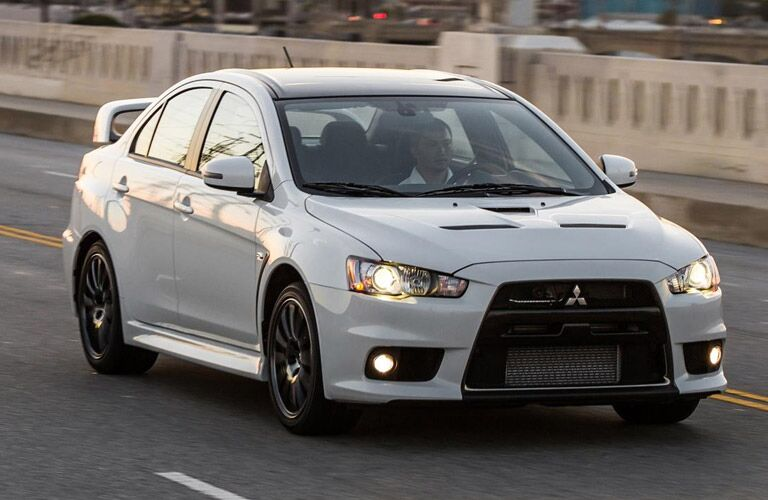 white Mitsubishi Lancer Evolution with spoiler