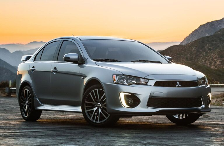 silver 2016 Mitsubishi Lancer at sunset