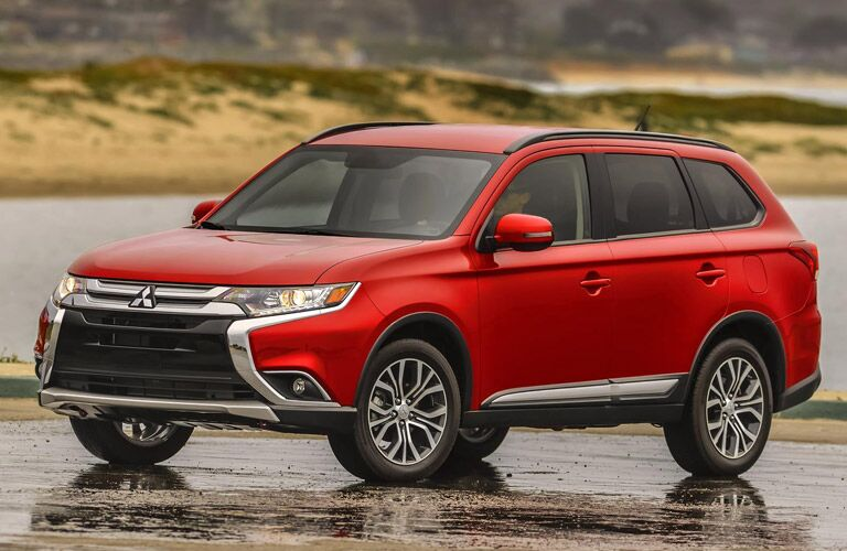 red 2016 Mitsubishi Outlander parked