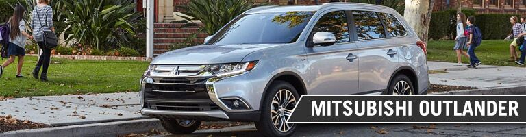 silver 2017 Mitsubishi Outlander parked on street