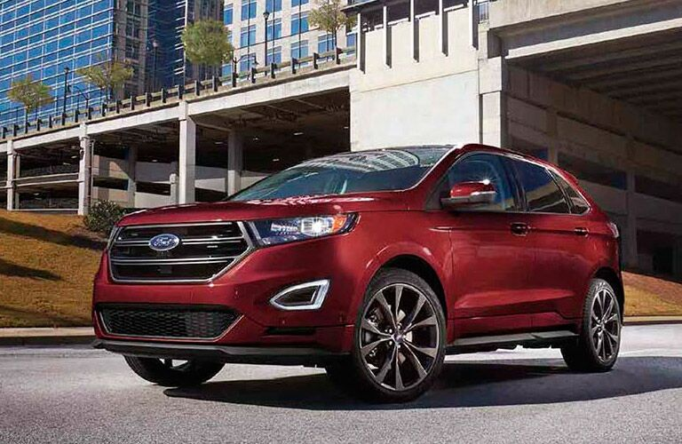 Red 2017 Ford Edge under a bridge