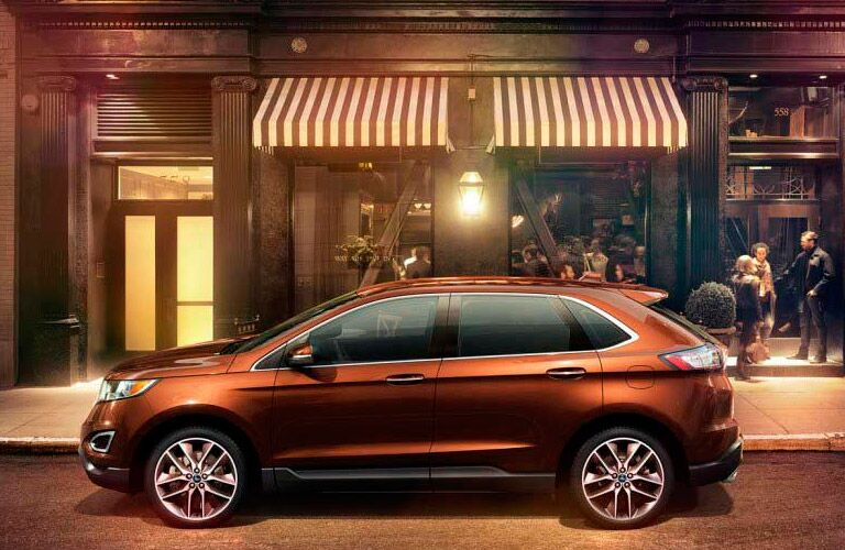 Orange 2017 Ford Edge on city street