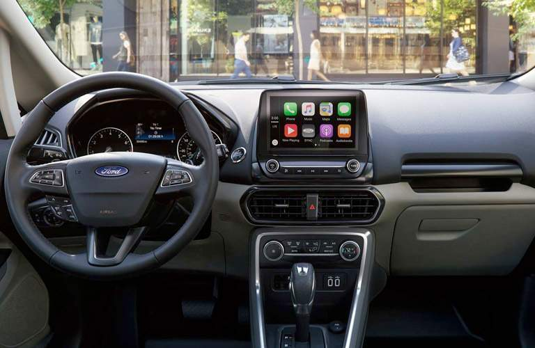 Steering wheel and center touchscreen of 2018 Ford EcoSport with gear shifter prominently shown in center