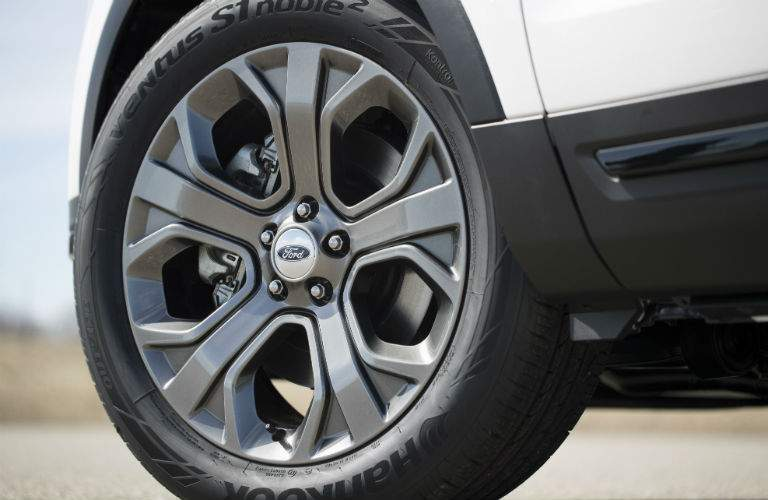 Isolated shot of 2018 Ford Explorer wheel with prominent rim