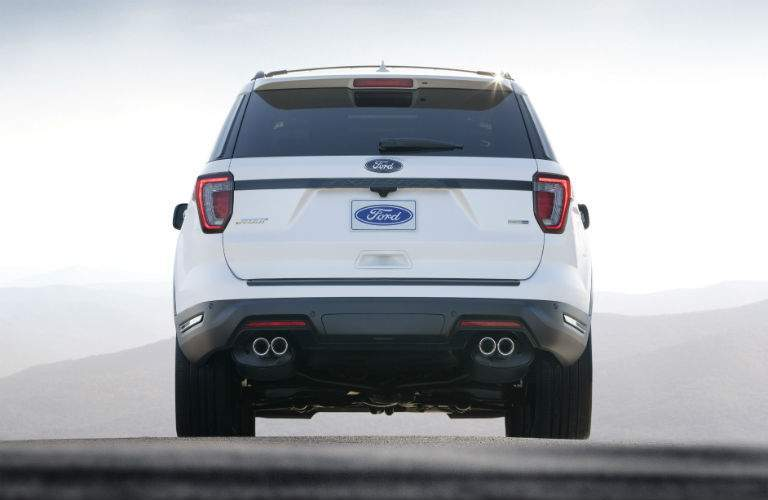 Rear shot of 2018 Ford Explorer with dual exhaust tips prominent in frame