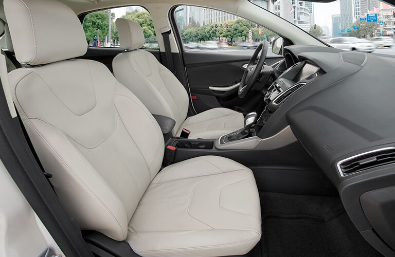 Front two seats inside 2018 Ford Focus with steering wheel in frame