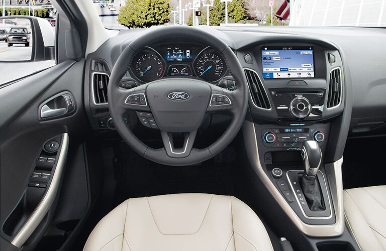 "Steering wheel and touchscreen of 2018 Ford Focus"" data-mce-src="