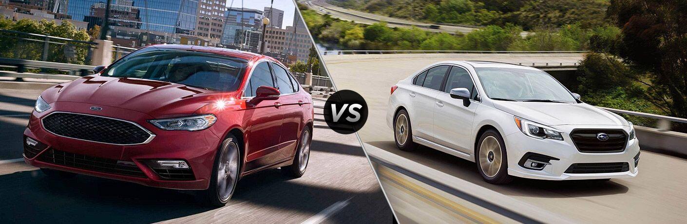 Red Ford Fusion and white Subaru Legacy in comparison picture