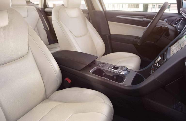 Front two seats of 2018 Ford Fusion with center console and touchscreen prominently shown