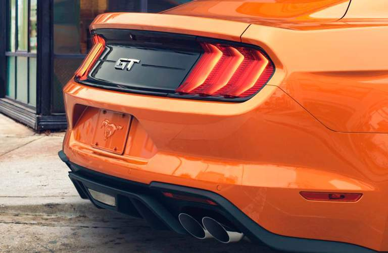 Rear view of orange 2018 Ford Mustang