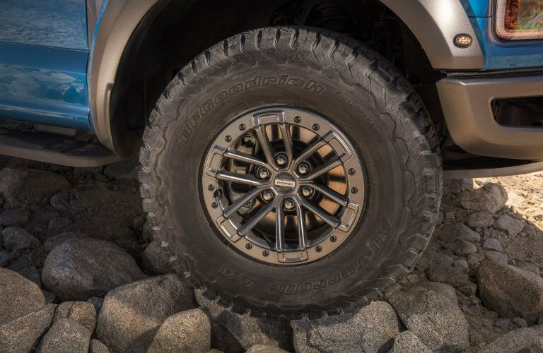 Closeup image of 2019 Ford F-150 Raptor tire to illustrate off-road capabilitiy