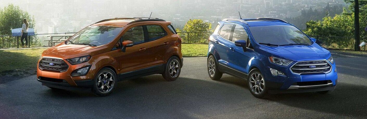 Orange and blue 2019 Ford EcoSport models parked next to each other at waterfront
