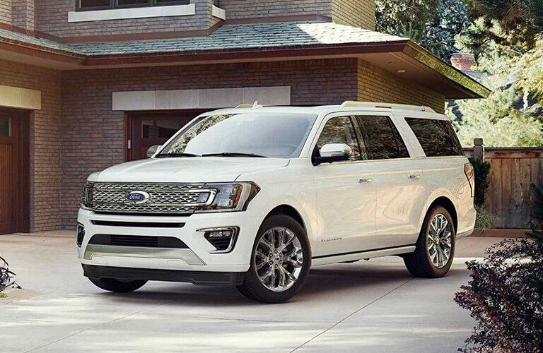 White 2019 Ford Expedition parked in front of modern styled house