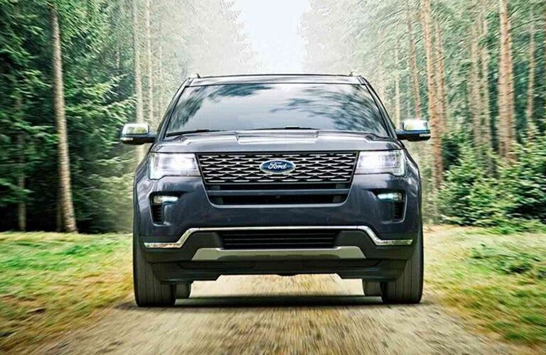 Front view of 2019 Ford Explorer driving in woods