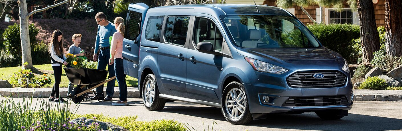Family loading garden supplies in the rear of 2019 Ford Transit Connect Wagon