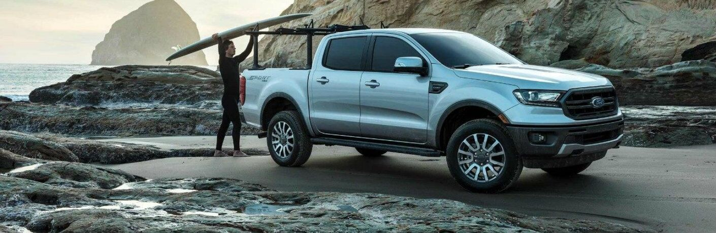 Individual loading up rear bed of 2019 Ford Ranger SuperCrew