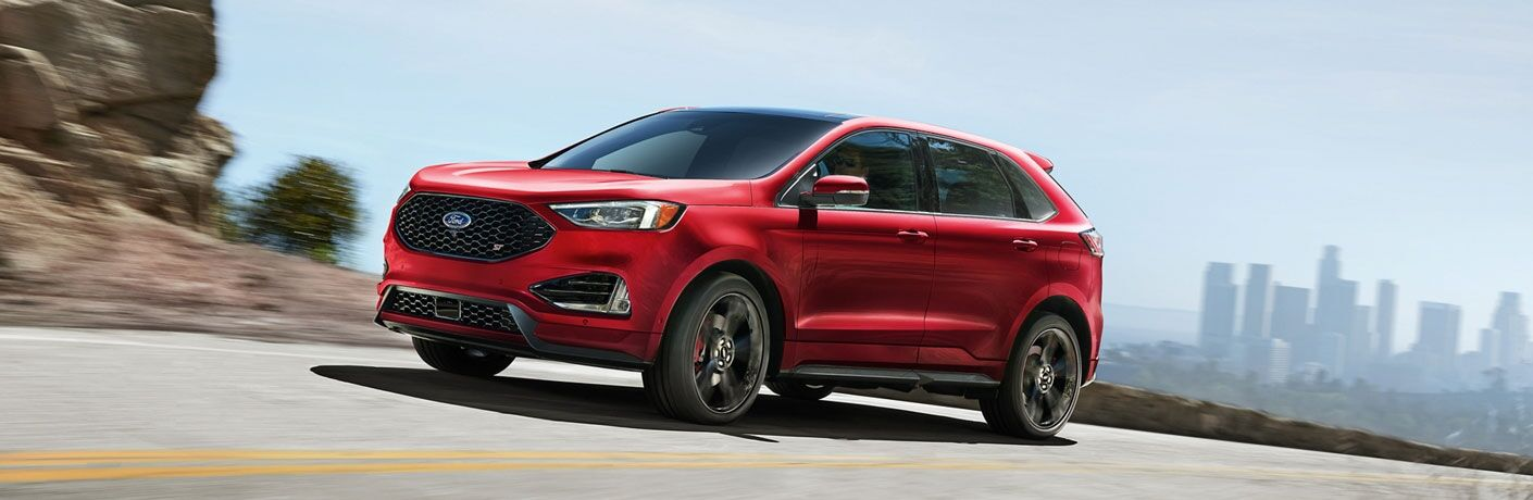 2020 Ford Edge exterior front fascia driver side on road with blurry rocks