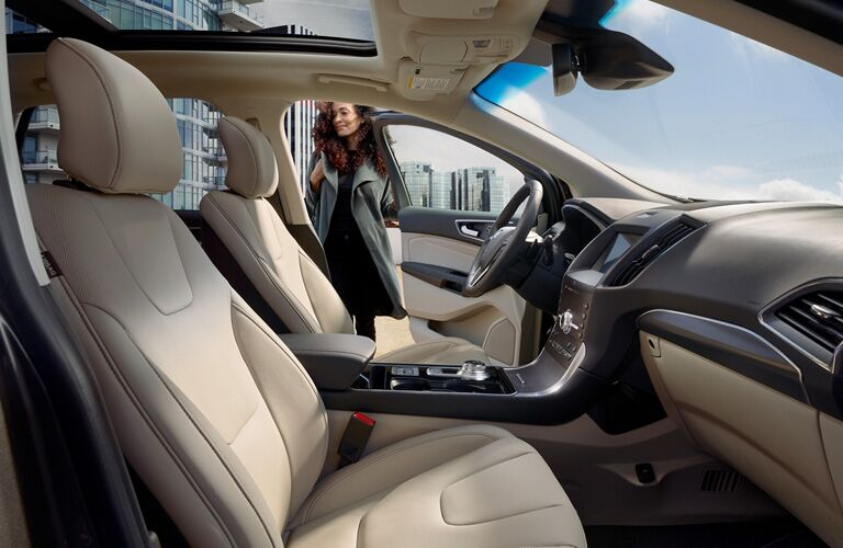 2020 Ford Edge interior side view seats steering wheel dashboard with woman getting into drivers side