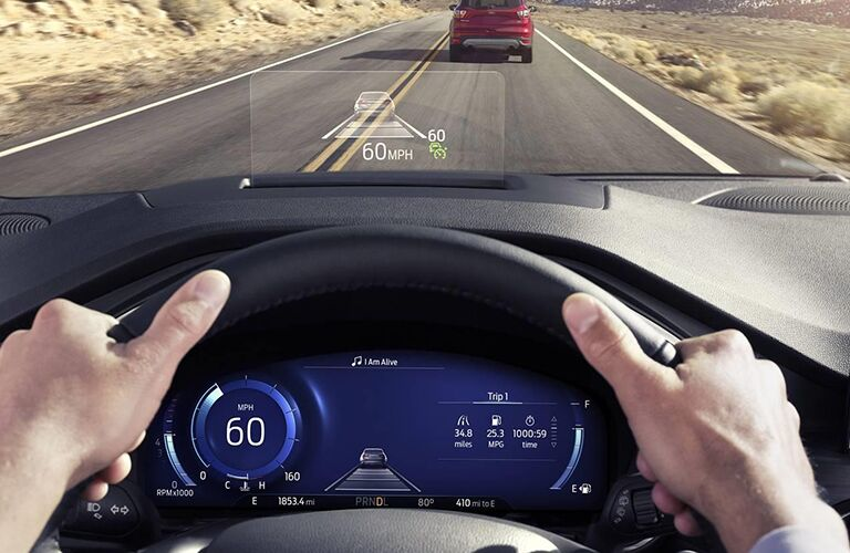 A HUD on the lower windshield displays the current speed along with the image of a vehicle.