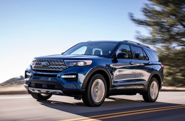 Blue 2020 Ford Explorer driving on country road