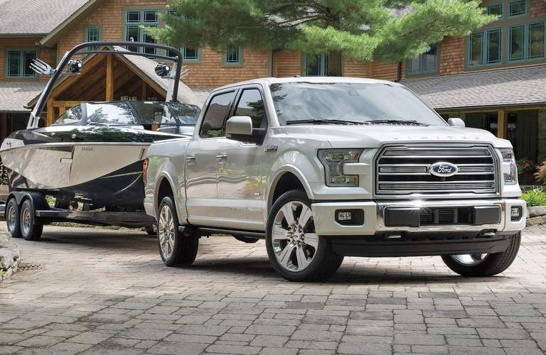 Silver 2016 Ford F-150 Towing a Boat