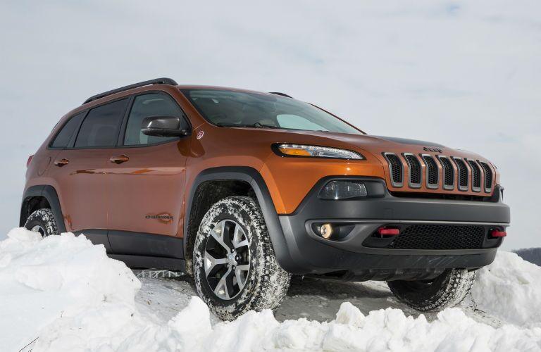 Orange 2016 Jeep Cherokee in Snow