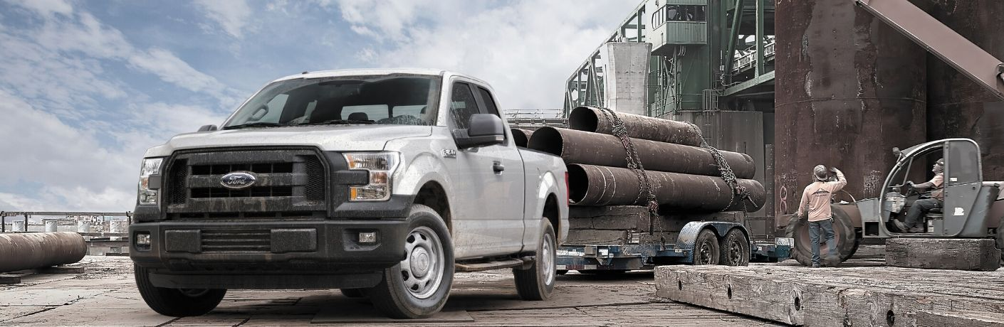 2015 Ford F-150 hauling trailer on construction side