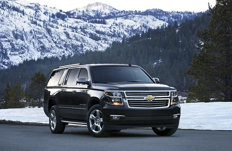 2016 Chevy Suburban in front of a snowy mountain