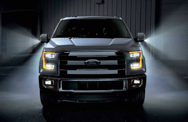 grille view of a 2016 Ford F-150 with dramatic lighting