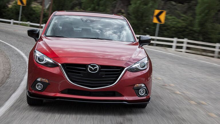 Head-on view of an approaching red 2016 Mazda3.