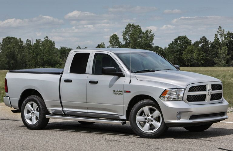Silver 2016 RAM 1500 drives up a highway